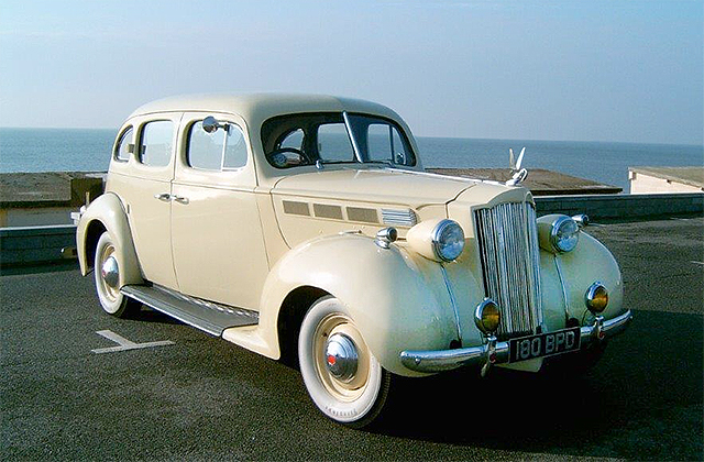 1938 Cream Packard 1600 Series Sedan